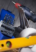 pic of triplets  - Set of different tools on wooden background - JPG