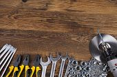 pic of triplets  - Working tools on wooden background - JPG
