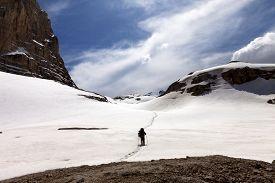 foto of plateau  - Hiker on snow plateau - JPG