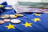Euro coins. Euro currency. Euro money. European flag and euro money. poster