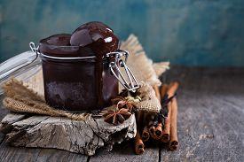 stock photo of cardamom  - Spicy chocolate sorbet in a jar with cinnamon and cardamom - JPG