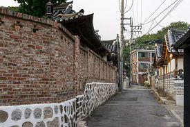 stock photo of dong  - Wonseo Dong alleyway street with baek hong beom - JPG