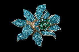 picture of brooch  - Colorful gem brooch brooch in the form of a flower on black background - JPG