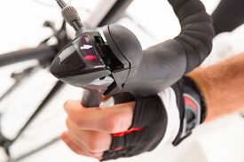pic of levers  - Hand pressing bicycle brake lever - JPG