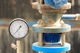 pic of manometer  - Manometer near old pipe on chemical plant - JPG