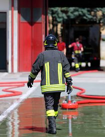 stock photo of firemen  - isolated Italian fireman with protective uniform and helmet on his head - JPG