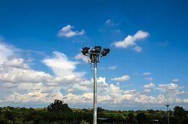 stock photo of light-pole  - Spot light pole with blue sky and cloud - JPG