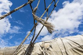 picture of sailing vessels  - Old ragged sailing rigging an ancient sailing vessel against cloudy sky - JPG