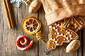 stock photo of pecan tree  - Christmas homemade gingerbread cookies on wooden table - JPG