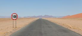 picture of mph  - Speed limit sign at a desert road in Namibia speed limit of 100 kph or mph - JPG