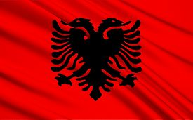 stock photo of albania  - The Flag of Albania is a red flag with a silhouetted black double - JPG