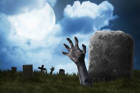 stock photo of terrific  - Zombie hand out from the graveyard - JPG
