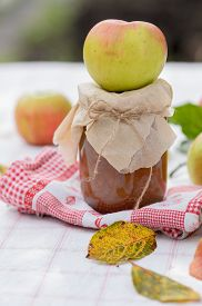 foto of indian apple  - Autumn apple jam with leaves and apples - JPG
