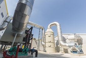 foto of pipeline  - New modern industrial waste plant pipelines from the outside - JPG