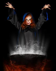 foto of cauldron  - Young witch with cauldron isolated on black - JPG