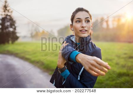 Woman stretching at park while