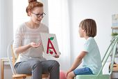 Friendly Speech Therapist And Boy poster