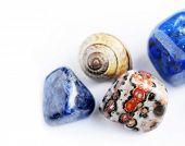beautiful precious stones against white background