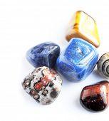 stock photo of lapis lazuli  - beautiful stones against white background - JPG