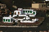 stock photo of hacienda  - miniature white spanish hacienda house set up - JPG