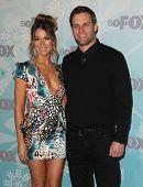 PASADENA, CA - JAN 11:  Natalie Zea & Travis Schuldt arrive at the FOX All-Star Party on January 11, 2011 in Pasadena, CA