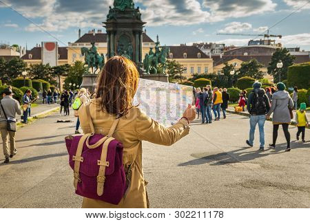 poster of Traveler Girl With Map In Vacation. Young Traveler Girl In Vacation. Girl Traveling Alone With Map I