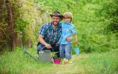 Take Care Of Plants. Boy And Father In Nature With Watering Can. Spring Garden. Dad Teaching Little  poster
