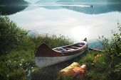 Canoe near a lake in morning lights
