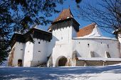Fortified church of Viscri (Weisskirch, Szaszfeheregyhaza) in Transylvania, Romania. UNESCO heritage