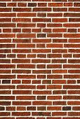 Red Brick Wall Close Up Background.