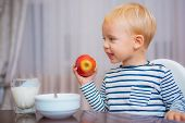 Child Eat Porridge. Kid Cute Boy Blue Eyes Sit At Table With Plate And Food. Healthy Food. Boy Cute  poster