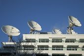 Satellite Dishes used for Broadcasting Mounted on Building