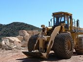 picture of jcb  - A yellow tractor style construction vehicle working in a quarry in Spain - JPG