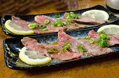 picture of wagyu  - raw wagyu beef with shallot and lemon  - JPG