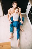 Two young people in love are together in the kitchen. Love affair, jeans. poster