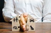 A Man Shares A House With His Palm With Images Of Property, Children And Pets. Divorce Concept, Prop poster