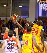 KUALA LUMPUR - FEBRUARY 19: Slingers' Donald Little (14) watches Louis Graham (24) blocks Dragons T.