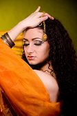 stock photo of yashmak  - Beautiful young woman in color arabian clothes - JPG