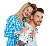 Front view of a stylish couple. beautiful friendly girl and guy together. Isolated over white backgr poster