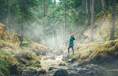 Girl Walking Through Forest On A Rainy Day. River In Forest Nature. Green Forest With Fog. Nature. R poster