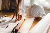 Professional Architect, Engineer Or Interior Planning Construction With Blueprint On Workplace Desk  poster