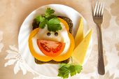 pic of scrambled eggs  - Sandwich with scrambled egg and vegetables like a smiling face - JPG