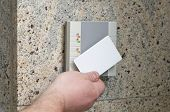 stock photo of precaution  - man puts the card into the reader access