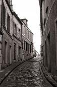 Small Village Narrow Cobblestone Street In France
