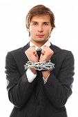 Handsome businessman hands chained over a white background