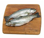Raw Trout On A Cutting Board On A White Background