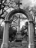 foto of embalming  - Cross on top of arch in the Greenwood Cemetery in Brooklyn  - JPG