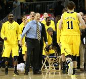 BROOKLYN-DEC 15: Michigan Wolverines head coach John Beilein (R) reacts with players against the Wes