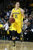 BROOKLYN-DEC 15: Michigan Wolverines guard Nik Stauskas (11) dribbles the ball against the West Virg