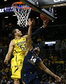 BROOKLYN-DEC 15: West Virginia Mountaineers guard Gary Browne (14) goes up for a shot as Michigan Wo